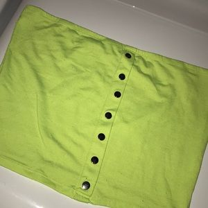 A lime green strapless crop top